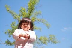 Smiling Japanese girl under the blue sky Stock Image