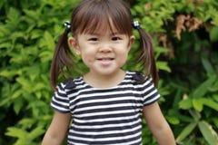 Smiling Japanese girl Stock Photo