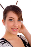 Smiling Japanese woman with hair sticks Royalty Free Stock Photo