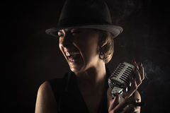 Smiling jazz singer with retro microphone Royalty Free Stock Photo