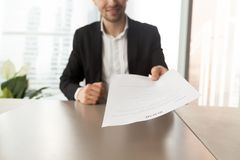 Smiling job applicant handing over resume to recruiter during in Stock Images