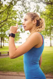 Smiling jogger woman drinking water Stock Photos