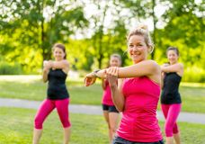 Smiling jogging coach stretching in th park Royalty Free Stock Photography