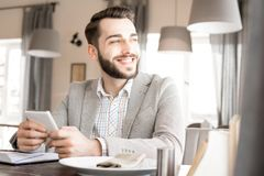Happy dreamy businessman resting in restaurant royalty free stock photography