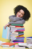 Smiling joyful girl along with multicolored books. Royalty Free Stock Photo