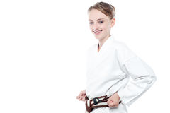 Smiling karate girl isolated over white. Little girl kung fu expert is ready for action Stock Photos