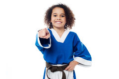 Smiling karate girl pointing towards you Royalty Free Stock Image