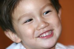 Smiling Kid. Smiling mixed Asian Caucasian 2 years old toddler Stock Photography