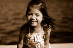 Smiling kid 2. A shot of a smiling asian kid palying at the park Royalty Free Stock Images