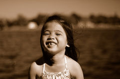 Smiling kid 3. A shot of an asian girl palying at the park Royalty Free Stock Photos