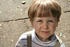 Smiling kid. A portrait of a smiling blue-eyed kid royalty free stock images