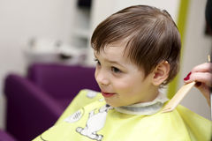 Smiling kid at the barbershop Royalty Free Stock Images