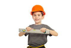 Smiling kid boy with bubble level Royalty Free Stock Images