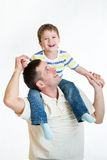Smiling kid boy riding dad's shoulders isolated. On white royalty free stock photos