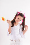 Smiling kid with candy Royalty Free Stock Images