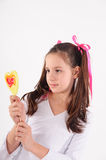 Smiling kid with candy Royalty Free Stock Image