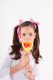 Smiling kid with candy Stock Photos