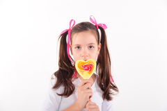 Smiling kid with candy Royalty Free Stock Photography