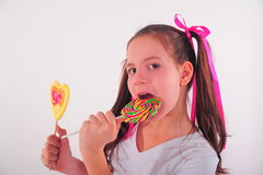 Smiling kid with candy Stock Image