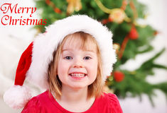 Smiling kid in Christmas hat Stock Image