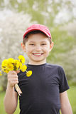 Smiling kid with dandelions Royalty Free Stock Photo