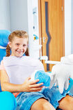 Smiling kid in a dentist chair Royalty Free Stock Photography