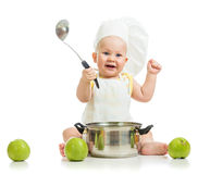 Smiling kid dressed as a cook with green apples Royalty Free Stock Photography