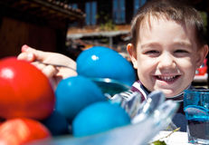 Smiling kid easter eggs Stock Images
