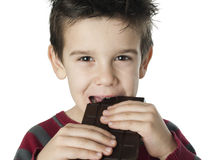 Smiling kid eating chocolate Stock Photography