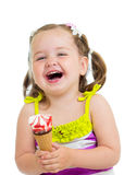 Smiling kid eating ice-cream isolated Stock Images