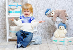 Smiling kid with gift boxes and teddy bears Royalty Free Stock Photo