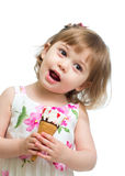 Smiling kid girl eating ice-cream Stock Photography