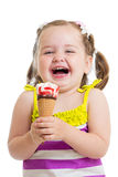 Smiling kid girl eating ice cream Stock Images