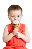 Smiling kid girl eating icecream Stock Images