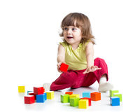 Smiling kid girl playing cubes toys Royalty Free Stock Photos