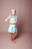 Smiling kid girl posing in studio Stock Image