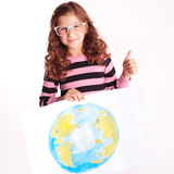 Smiling kid girl with poster on white. Smiling kid girl holding poster with globe on white stock photos