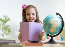 Smiling kid with opened book Stock Image