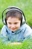 Smiling kid in headphones Stock Photo