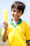 Smiling Kid Holding An Ice-cream Stock Images