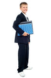 Smiling kid holding files, young business boy Stock Photography