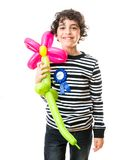 Smiling Kid holding a flower balloon during his birthday party Stock Photos