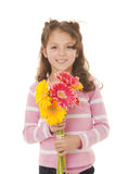 Kid gift of flowers. Smiling kid holding gift of flowers Stock Image