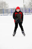 Smiling kid on the ice rink Stock Photo