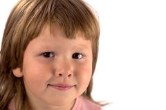 Smiling kid looking at you. Portrait of Smiling kid wearing pink closes looking at you isolated on white Stock Photo