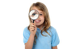 Smiling kid with magnifying glass Stock Image