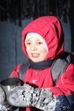 Smiling kid with mug Stock Image