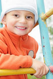 Smiling kid in orange on climbing staircase Royalty Free Stock Photos