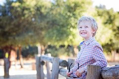 Smiling kid in park royalty free stock photo