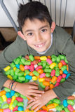 Smiling kid playng with colorful corn toys Royalty Free Stock Image